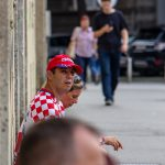 Seated Croatia fan waiting for the tram